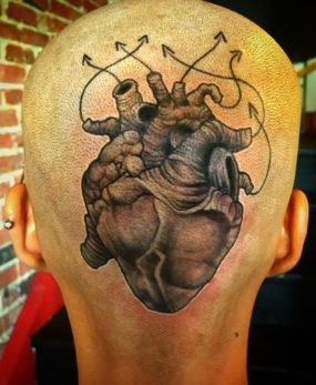 Anatomical heart on head tattooed by Chad
