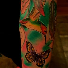 Butterfly and humming bird piece tattooed by Chad