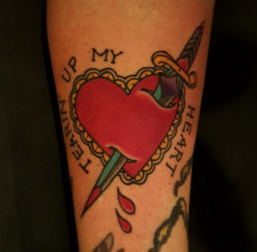 Heart with knife tattooed by Chad