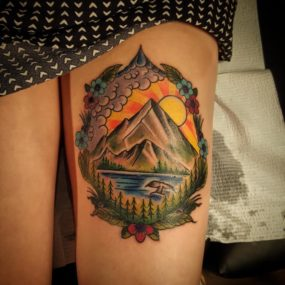 PNW mountain scene on leg tattooed by Chad