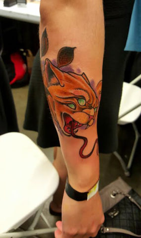Traditional cat with snake tongue tattooed by Chad