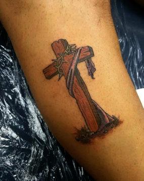 Cross tattooed by Kyle
