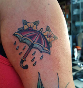 Traditional umbrella tattooed by Kyle