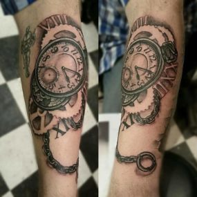 Clock Tattoo done by Shain at Laughing Buddha Tattoo & Body Piercing Seattle, WA. Capitol Hill