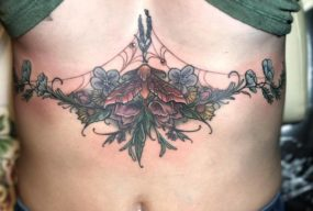 Moth Flowers Tattoo done by Shain at Laughing Buddha Tattoo & Body Piercing Seattle, WA. Capitol Hill