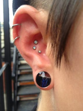 Conch Piercing with White Opals done at Laughing Buddha Tattoo & Body Piercing Seattle, WA Capitol Hill