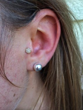 Tragus piercing done at Laughing Buddha Tattoo & Body Piercing Seattle, WA Capitol Hill