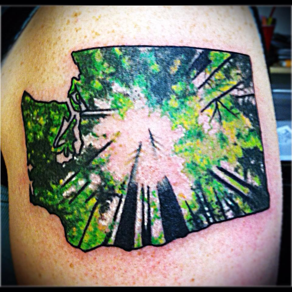 washington state evergreen tree tattoo at laughing buddha tattoo parlor Seattle