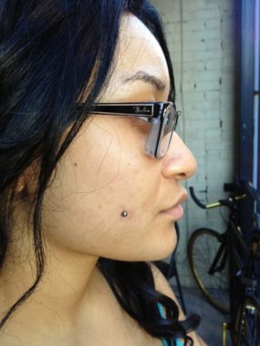Cheek piercing by Colin O at Laughing Buddha Seattle, WA Capitol Hill