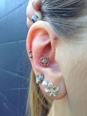 Conch piercing by Colin O at Laughing Buddha Seattle, WA Capitol Hill