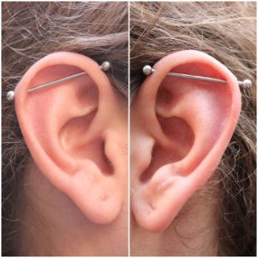 Pair of Industrial piercing by Colin O at Laughing Buddha Seattle, WA Capitol Hill