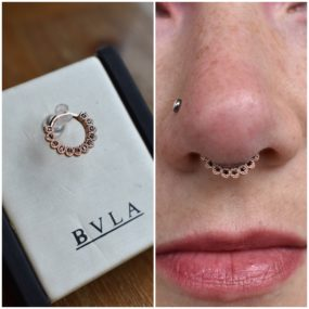 Septum Piercing with 14k Gold from BVLA piercing by Colin O at Laughing Buddha Seattle, WA Capitol Hill